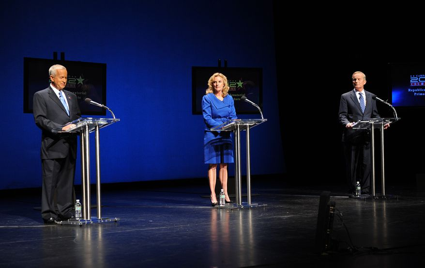 Three Republican candidates for the U.S. Senate — St. Louis businessman John Brunner (left), former Missouri state Treasurer Sarah Steelman and Rep. W. Todd Akin — are introduced at the start of a debate at Washington University in St. Louis on July 6, 2012. The candidates are competing to challenge Sen. Claire McCaskill in the November election. (Associated Press/St. Louis Post-Dispatch)