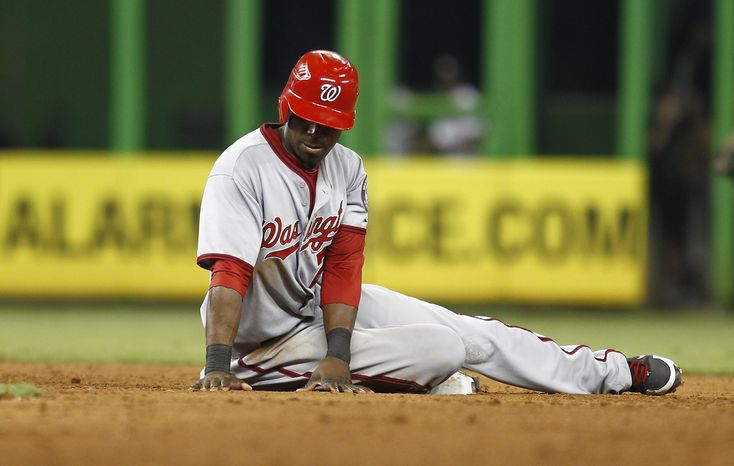 Washington Nationals runner Roger Bernadina sits on second base after being forced out in a sixth inning double play with bases loaded during a MLB baseball game in Miami, Monday, July 16, 2012. The Marlins won 5-3. (AP Photo/J Pat Carter)