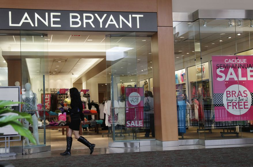 A shopper walks into a Lane Bryant store in San Jose, Calif., on Friday, June 15, 2012. (AP Photo/Paul Sakuma)