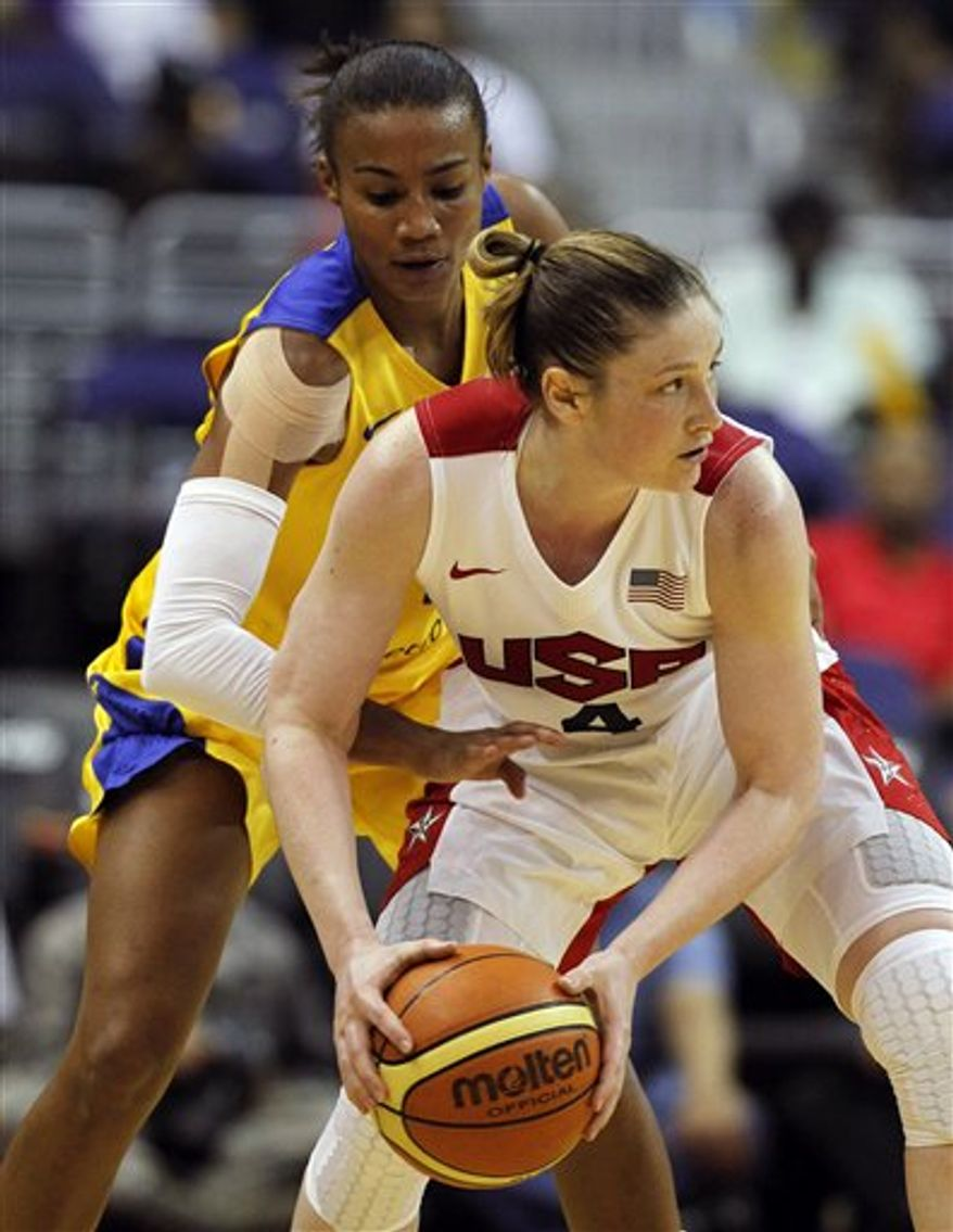 Team USA guard Lindsay Whalen, front, looks to pass around Brazil defender Joice Cristina De Souza Rodrigues during the second half of an Olympic women's exhibition basketball game, Monday, July 16, 2012, in Washington. USA won 99-67. (AP Photo/Alex Brandon)