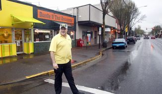 """Jack Koehler, business has been up since he put Simpson statues in front of Sweety's Frozen Yogurt store in Springfield, Ore., a nod to """"The Simpsons"""" creator Matt Groening, who used a city in his native state as a model for the show. (Associated Press)"""
