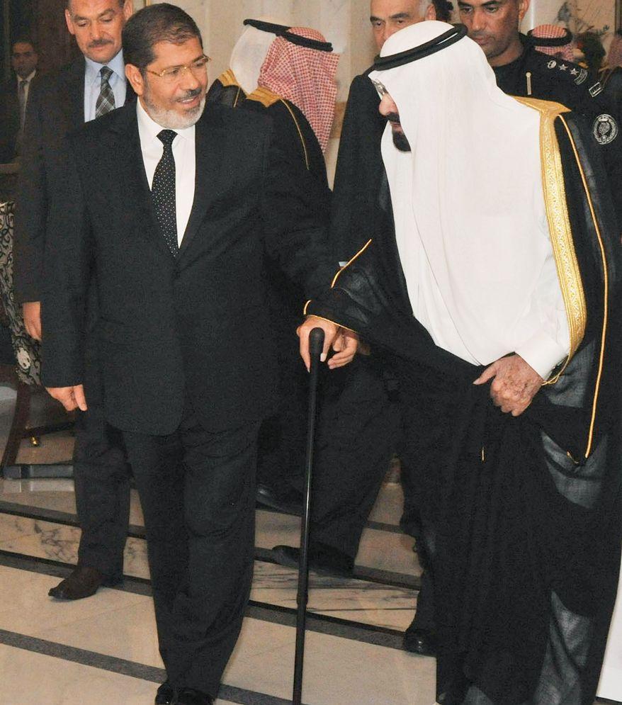 ** FILE ** Saudi King Abdullah bin Abdulaziz (right) is visted by Egyptian President Mohammed Morsi at the al-Salam palace in Jeddah, Saudi Arabia, 2012. (Associated Press)