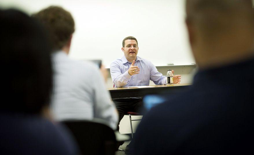 George Washington University adjunct professor Brett Di Resta has served as an opposition researcher on numerous Democratic campaigns. (Rod Lamkey Jr./The Washington Times)