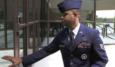 U.S. Air Force Staff Sgt. Luis A. Walker arrives July 16, 2012, from a lunch break during his court martial at Lackland Air Force Base in San Antonio. Walker, a former training officer, is charged with illicit sexual contact with 10 female trainees. He is facing 28 counts including rape and is one of 12 instructors under investigation. (Associated Press/The San Antonio Express-News, Jerry Lara)