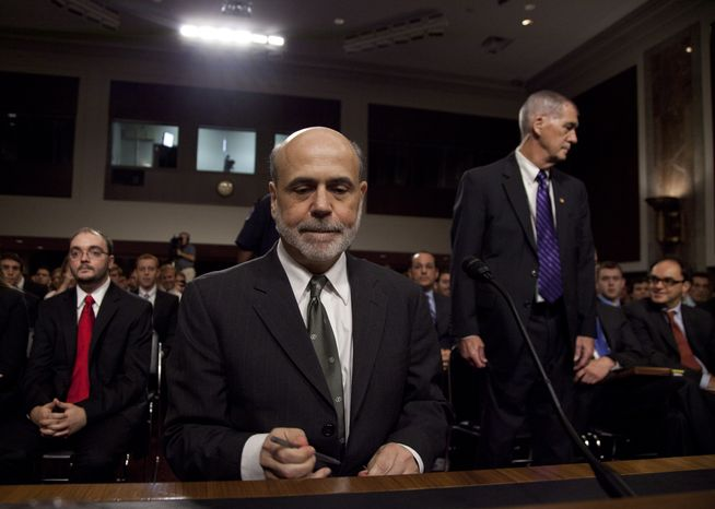 Federal Reserve Chairman Ben S. Bernanke pauses as he arrives to give his semiannual report to the Senate Banking Committee on Tuesday, July 17, 2012, on Capitol Hill in Washington. (AP Photo/Carolyn Kaster)