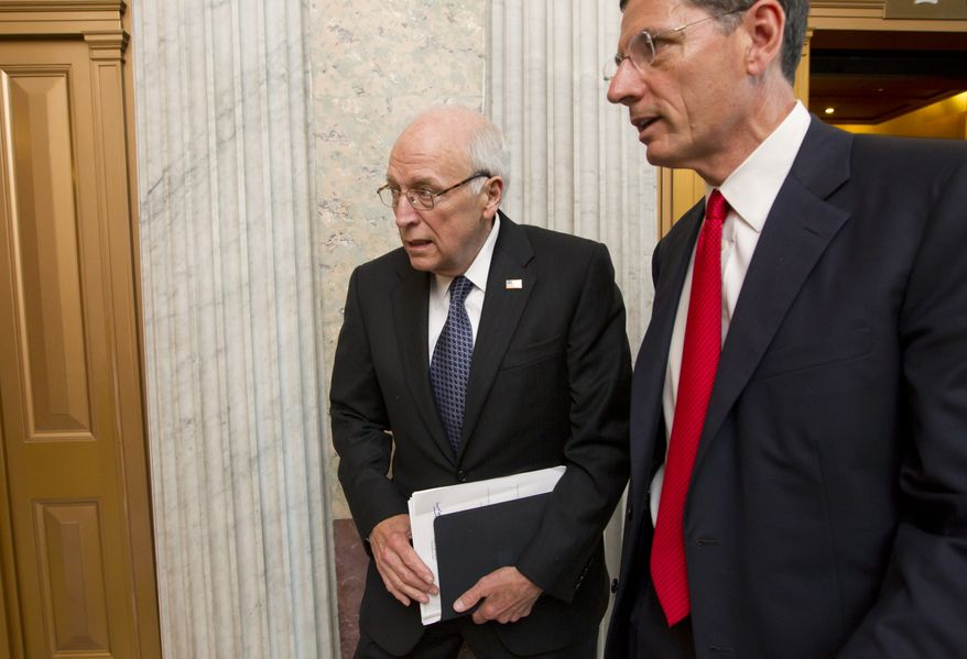 Former Vice President Dick Cheney, who also served five terms as Wyoming's representative in the House, returns July 17, 2012, to the Capitol in Washington to meet with Senate Republican leaders at a political strategy luncheon. He is accompanied by Sen. John Barrasso of Wyoming, the Republican Policy Committee chairman. (Associated Press)