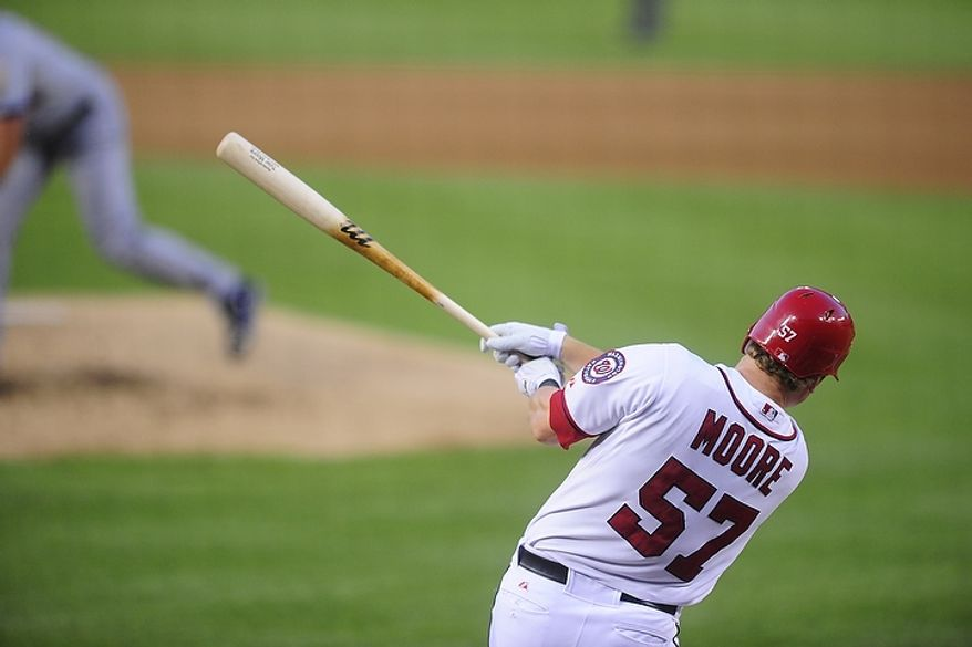 Tyler Moore hits a solo home run in the bottom of the fifth inning during the Washington Nationals game against the New York Mets at Nationals Park, Washington D.C.,Tuesday, July 17, 2012.   (Ryan M.L. Young/The Washington Times)