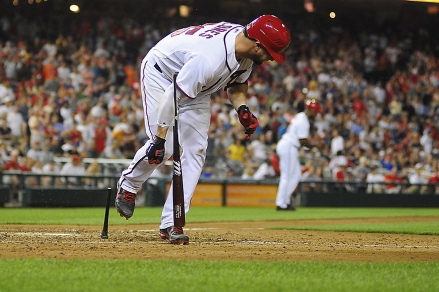 Jesus Flores slams his bat in frustration, breaking it in two, after striking out to end the bottom of the ninth with the game tied at 3-3 during the Washington Nationals game against the New York Mets at Nationals Park, Washington D.C.,Tuesday, July 17, 2012.   (Ryan M.L. Young/The Washington Times)
