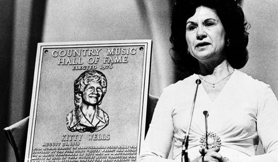 Country music superstar Kitty Wells is inducted into the Country Music Hall of Fame during the Country Music Association (CMA) awards in 1976 in Nashville, Tenn. (Associated Press)