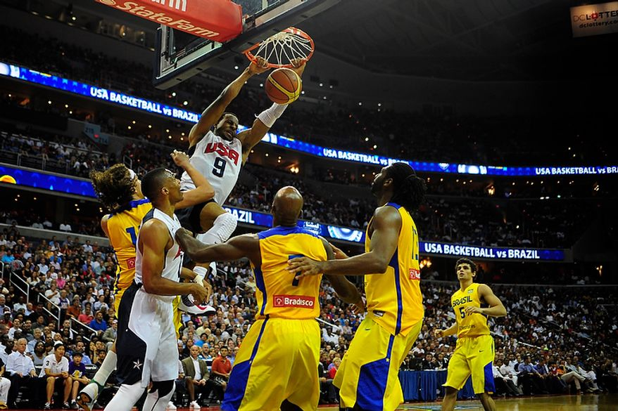 Team USA guard Andre Iguodala (9) dunks during an exhibition game July 16, 2012, between the U.S. men's basketball team and Brazil at Verizon Center in D.C. (Ryan M.L. Young/The Washington Times)