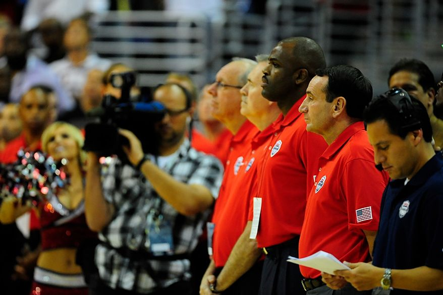 Team USA head coach Mike Krzyzewski (second from right) watches during an exhibition game July 16, 2012, between the U.S. men's basketball team and Brazil at Verizon Center in D.C. (Ryan M.L. Young/The Washington Times)