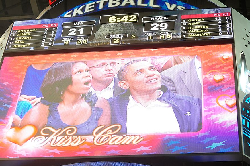 """First lady MIchelle Obama looks up in surprise after realizing that she and President Obama are on the """"Kiss Cam"""" during an exhibition game July 16, 2012, between the U.S. men's basketball team and Brazil at Verizon Center in D.C. (Ryan M.L. Young/The Washington Times)"""