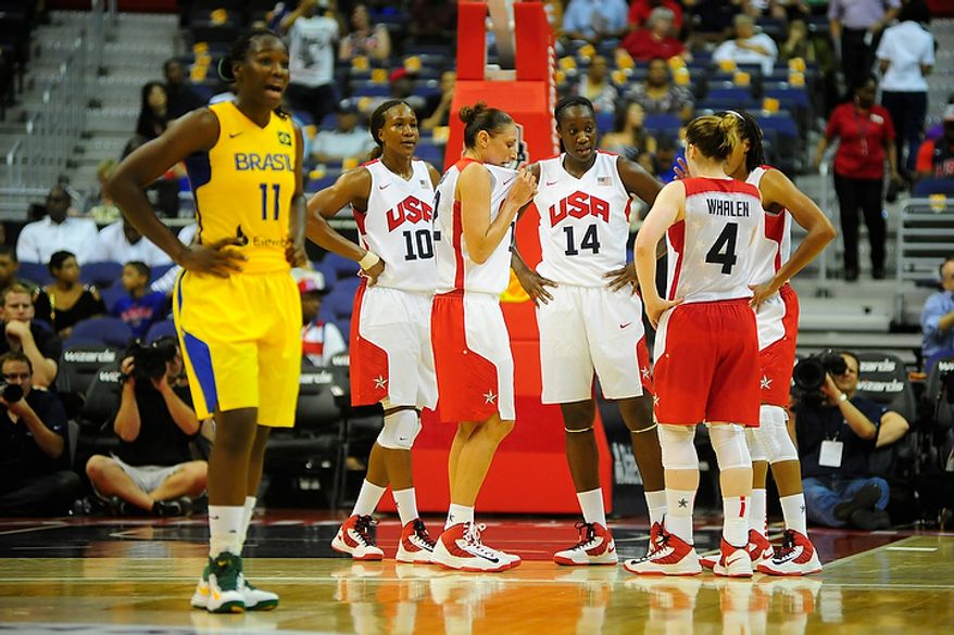 Team USA members (from left) Tamika Catchings (10), Diana Taurasi (12), Tina Charles (14) and Lindsay Whalen (4) gather following a play while Brazil's Clarissa Cristina Dos Santos (11) reacts to a call during an exhibition game July 16, 2012, between the U.S. women's basketball team and Brazil at Verizon Center in D.C. (Ryan M.L. Young/The Washington Times)