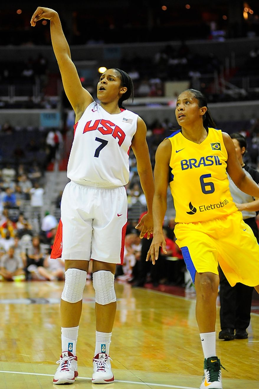 Team USA forward Maya Moore (7) watches her shot with Brazil's Patricia De Oliveira Ferreira during an exhibition game July 16, 2012, between the U.S. women's basketball team and Brazil at Verizon Center in D.C. (Ryan M.L. Young/The Washington Times)