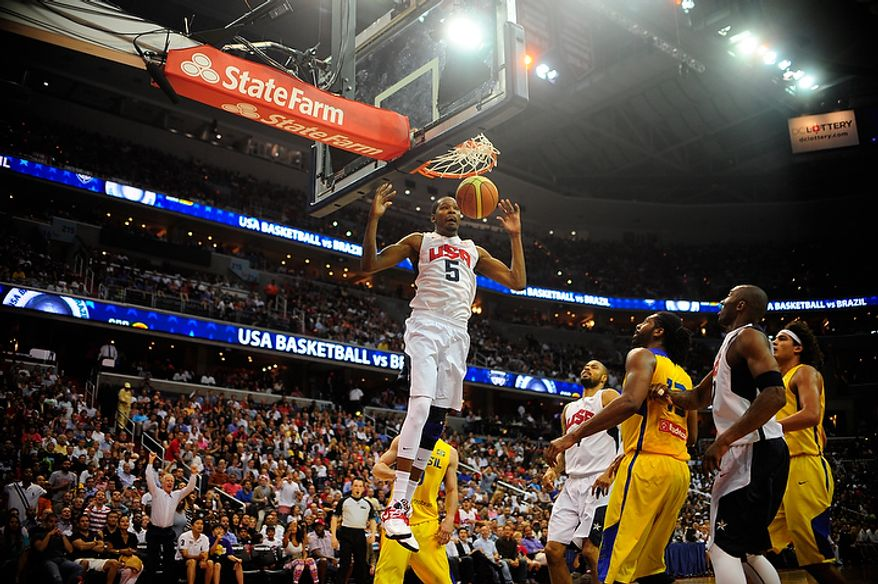 Team USA forward Kevin Durant (5) dunks during an exhibition game July 16, 2012, between the U.S. men's basketball team and Brazil at Verizon Center in D.C. (Ryan M.L. Young/The Washington Times)