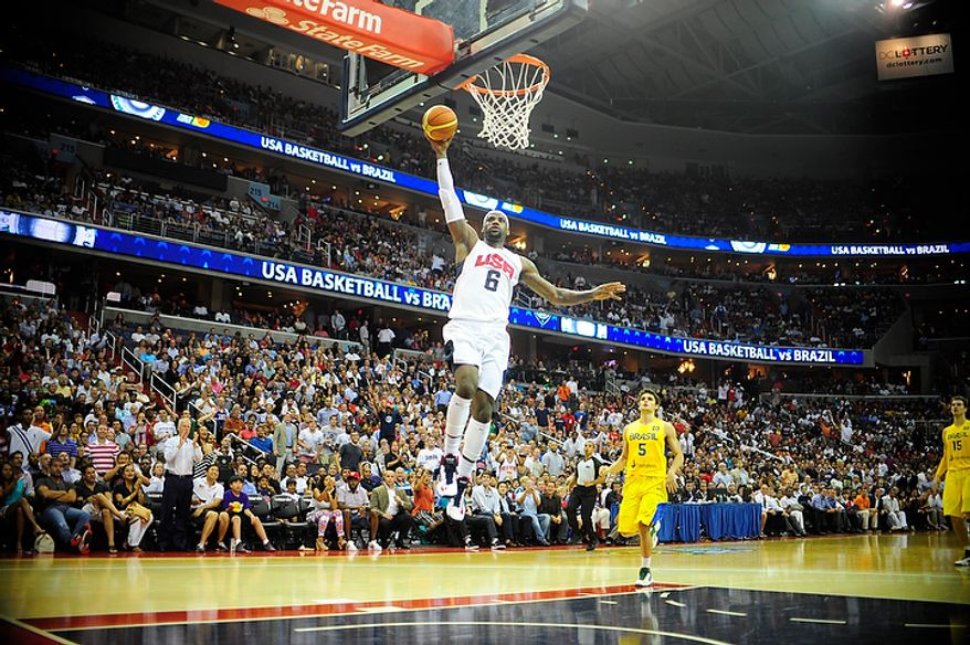 Team USA forward LeBron James (6) dunks during an exhibition game July 16, 2012, between the U.S. women's basketball team and Brazil at Verizon Center in D.C. (Ryan M.L. Young/The Washington Times)