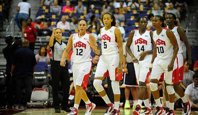 Team USA members (from left) Diana Taurasi (12), Seimone Augustus (5), Tina Charles (14), Tamika Catchings (10), and Sylvia Fowles (13) take the court during an exhibition game July 16, 2012, between the U.S. women's basketball team and Brazil at Verizon Center in D.C. (Ryan M.L. Young/The Washington Times)