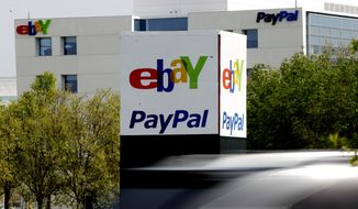 ** FILE ** In this Thursday, March 29, 2012, file photo, a vehicle drives in front of the PayPal/eBay offices in San Jose, Calif. (AP Photo/Paul Sakuma, File)