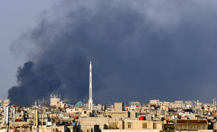 In this citizen journalist image, smoke billows July 18, 2012, over Damascus, Syria, after a bomb ripped through a high-level security meeting and killed three top regime officials, including President Bashar Assad's brother-in-law. (Associated Press)