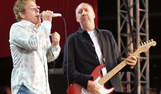 "** FILE ** In this July 2, 2006 photo, Roger Daltrey and Pete Townshend of The Who are shown during their performance at the Hyde Park Music Festival, in London. Daltrey and Townshend are taking ""Quadrophenia"" and other Who classics on the road for a U.S. tour this fall, but first plan what Daltrey calls a great finale for the Olympic Games in London. (AP Photo/ Max Nash, File)"