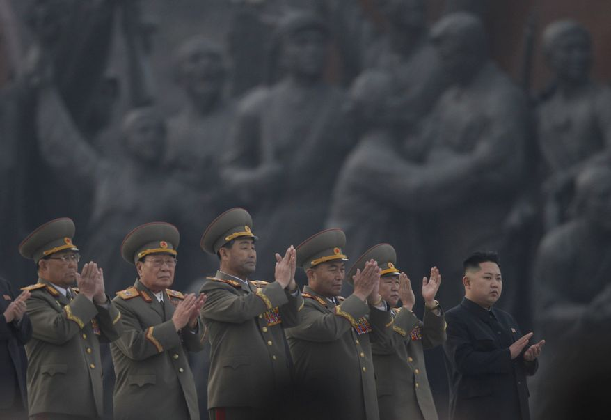 FILE - In this April 13, 2012 file photo, North Korean leader Kim Jong Un, right, applauds with military officers as he attends the unveiling ceremony of statues of late leaders, Kim Il Sung and Kim Jong Il on Mansudae in Pyongyang, North Korea.  (AP Photo/Vincent Yu, File)