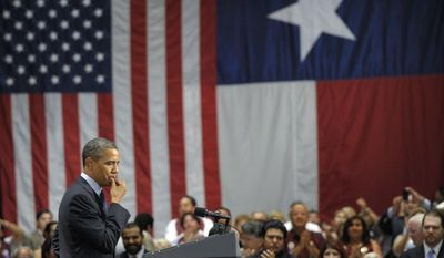 President Obama pauses as the audience applauds during his speech at a fundraising event at the Henry B. Gonzalez Convention Center in San Antonio on Tuesday, July 17, 2012. (AP Photo/Susan Walsh)