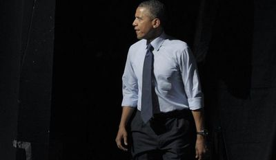 President Obama walks on stage to speak July 17, 2012, at a fundraising event at the Austin Music Hall in Austin, Texas. (Associated Press)