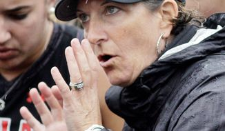 Maryland coach Missy Meharg gestures as she talks to her team during a timeout in the NCAA Field Hockey Championship in Louisville, Ky., Sunday, Nov. 20, 2011. Maryland successfully defended its title, beating North Carolina 3-2 in overtime.  (AP Photo/Garry Jones)