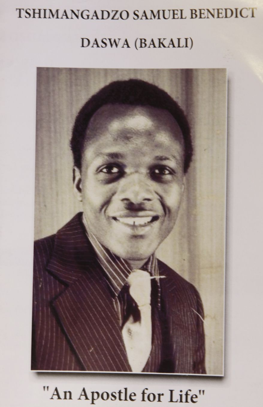This Friday, June 15, 2012 photo shows a pamphlet in Johannesburg promoting the canonization process of Benedict Daswa. The Catholic schoolteacher, revered for his good deeds, honesty and compassion, was also a fierce foe of the witchcraft widely practiced here. When a lightning bolt struck the village and Daswa resisted the elders' call for hiring an exorcist, he was chased into a pub and beaten to death. Twenty-two years later, his memory is still so revered that he has been nominated as South Africa's first saint. The Vatican is studying the application. Daswa, who was born Tshimangadzo Samuel and raised in a traditionalist South African family, changed his name when he became a Catholic. (AP Photo/Denis Farrell)