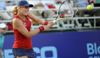 Washington Kastles' Anastasia Rodionova returns the ball against the New York Sportimes during a World TeamTennis mixed doubles match, Thursday, July 12, 2012, in Washington. (AP Photo/Nick Wass)