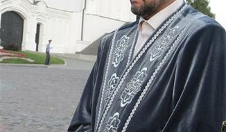 In this Thursday, July 14, 2011 file photo, Ildus Faizov, a top Muslim cleric in the Volga River province of Tatarstan, addresses Russia's then-premier Vladimir Putin, unseen, in Kazan, about 700 kilometers (450 miles) east of Moscow. Faizov, known for his criticism of radical Islamist groups known as Salafists, was wounded Thursday,J uly 19, 2012, after an explosive device ripped through his car in Kazan. (AP Photo/RIA Novosti, Alexei Nikolsky, Pool, File)