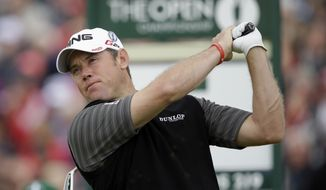 Lee Westwood of England plays a shot off the fifth tee at Royal Lytham & St Annes golf club during the first round of the British Open Golf Championship, Lytham St Annes, England, Thursday, July 19, 2012. (AP Photo/Tim Hales)