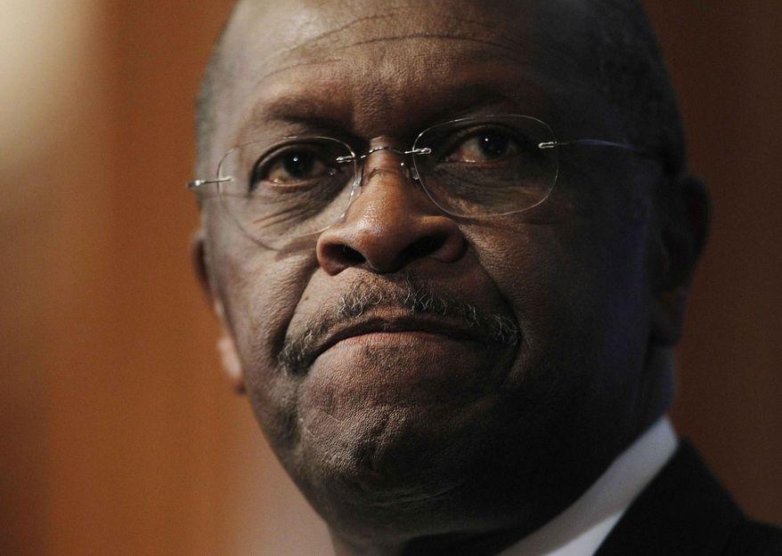 Herman Cain (Associated Press) ** FILE **