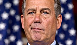 House Speaker John Boehner, Ohio Republican, talks July 19, 2012, to reporters on Capitol Hill. (Associated Press)