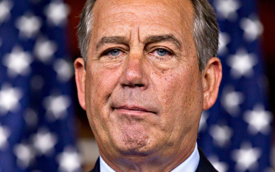 House Speaker John Boehner, Ohio Republican, talks July 19, 2012, to reporters on Capitol Hill. (Associated Press)