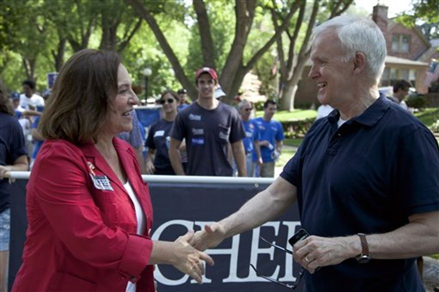 Nebraska state Sen. Deb Fischer (left), a candidate for Republican senate, meets Democratic Senate candidate Bob Kerrey at a Fourth of July parade in Omaha, Neb. Fischer is running against Kerrey for the senate seat vacated by Democrat Ben Nelson. (Associated Press)