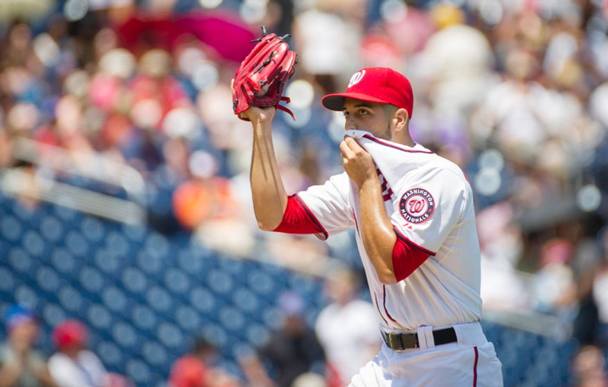 Gio Gonzalez reacts to giving up a home run to New York Mets Ike Davis in the top of the second inning. (Rod Lamkey Jr./The Washington Times)
