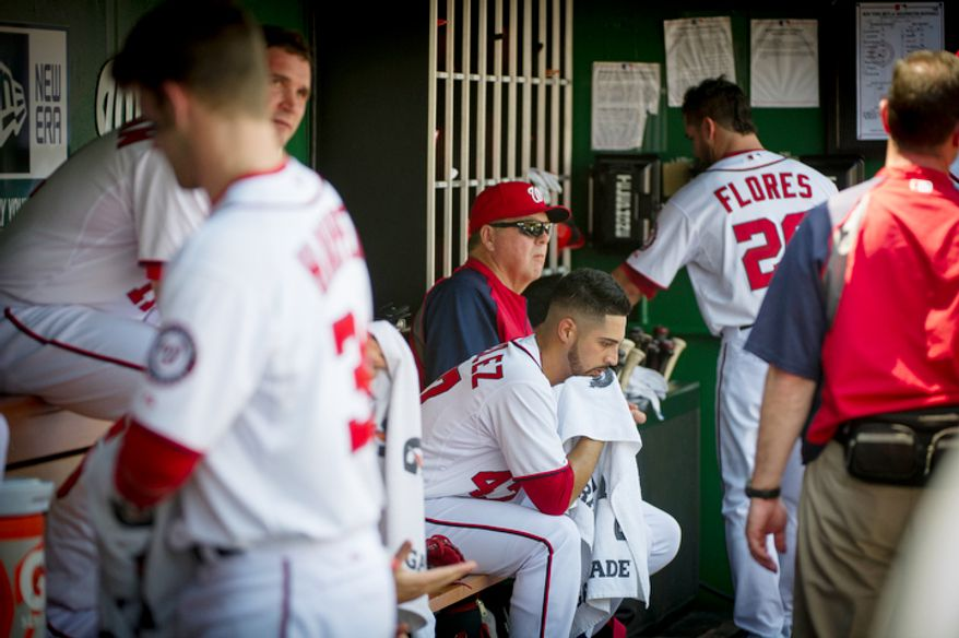 Gio Gonzalez sits in the dugout in the bottom of the second inning after giving up two home runs. (Rod Lamkey Jr./The Washington Times)