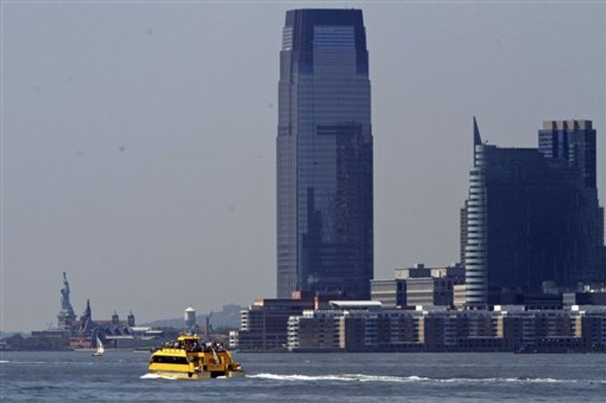 A water taxi is seen from the Hudson River Park in New York. (AP Photo/Mary Altaffer)