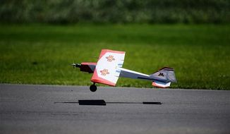 An unmanned aerial vehicle named Odin makes a safe landing while under the operation of aerospace engineering and mechanics master's student Arion Mangio. Odin is a precursor to Thor, which operates tests on enhanced software developed through Odin. (AP Photo/The Minnesota Daily, Marisa Wojcik)