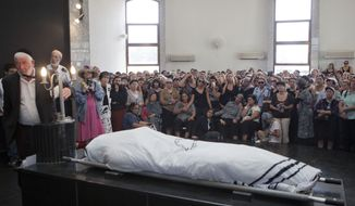 Family and friends attend the funeral of Itzik Kolengi, 28, in Petah Tikva, Israel, on Friday, July 20, 2012. Mr. Kolengi was killed and his wife injured in a suicide bombing near the Burgos, Bulgaria, airport two days earlier. (Associated Press)