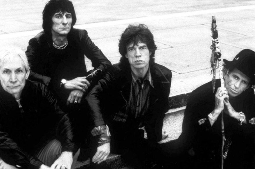 The Rolling Stones' (from left) Charlie Watts, Ron Wood, Mick Jagger and Keith Richards pose for a 1998 group portrait. (Associated Press)