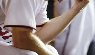 Washington Nationals starting pitcher Stephen Strasburg sits in the dugout after being lifted in the sixth inning of a baseball game against the Atlanta Braves, Friday, July 20, 2012, in Washington. The Braves won 11-10 in 11 innings. (AP Photo/Carolyn Kaster)