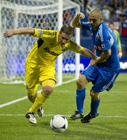 Columbus Crew's Chris Birchall (left) scored the lone goal in the defeat of D.C. United on Saturday night. (AP Photo/The Canadian Press, Paul Chiasson)