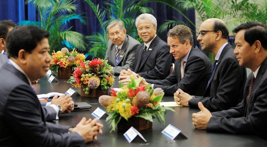 U.S. Treasury Secretary Timothy F. Geithner (third from right) talks with Myanmar Minister of Finance Hla Tun (right) and government officials from Cambodia, Brunei, Malaysia and Singapore during a meeting with Association of Southeast Asian nations finance ministers at the Asia-Pacific Economic Cooperation summit in Honolulu in November 2011. Myanmar appeals to U.S. commercial ventures. (Associated Press)