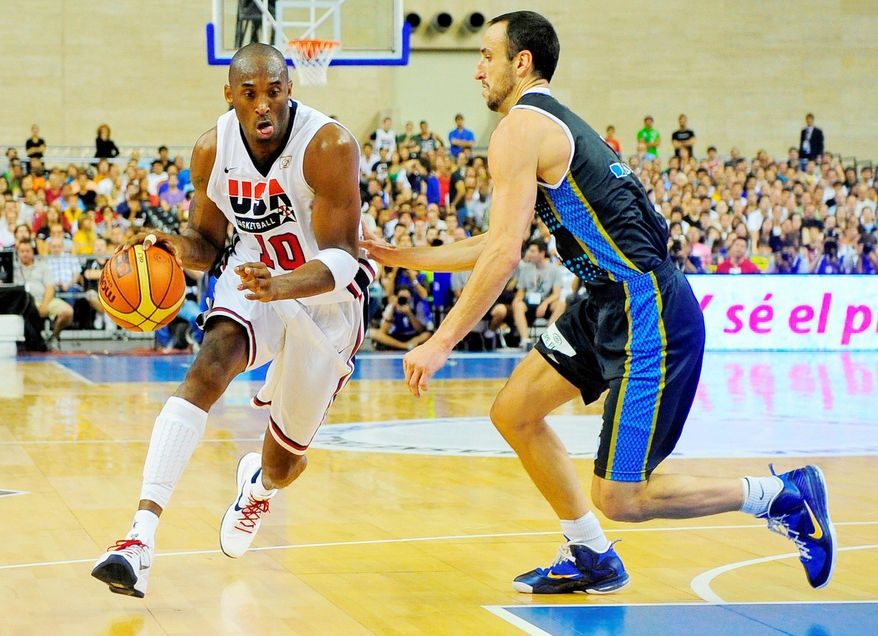 Kobe Bryant of the US Men's Senior National Team drives for the ball against Emmanuel Ginobili of the Argentina Men's Senior National Team during their Pre-Olympic friendly basketball match at the Palau Sant Jordi in Barcelona, Spain, Sunday, July 22, 2012. (AP Photo/Manu Fernandez)