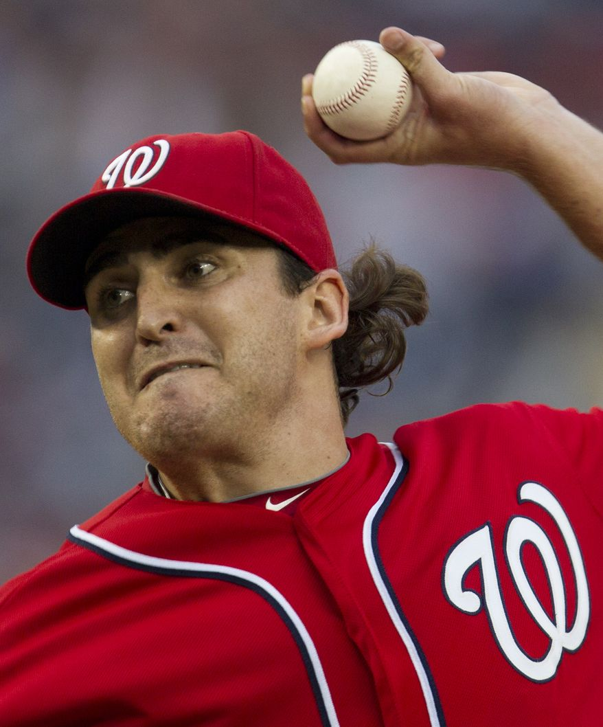 Washington Nationals starting pitcher John Lannan delivered seven strong innings in the 5-2 win Saturday night over the Atlanta Braves. (AP Photo/Carolyn Kaster)