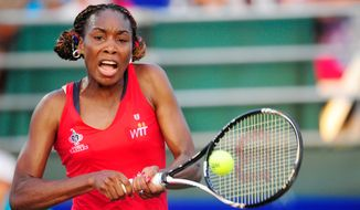 Venus Williams hits a ball while playing in a World Team Tennis match between the Washington Kastles and the Kansas City Explorers, Washington D.C., Sunday, July 22, 2012.   (Ryan M.L. Young/The Washington Times)