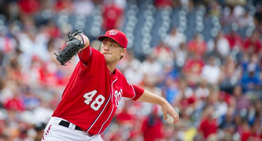 Nationals' Ross Detwiler delivers in the top of the first inning against the Braves as the Washington Nationals host the Atlanta Braves at Nationals Park in Washington, D.C., Sunday, July 22, 2012. (Rod Lamkey Jr./The Washington Times)