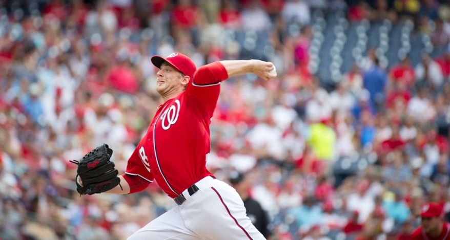 Nationals' Ross Detwiler delivers in the top of the first inning against the Braves. (Rod Lamkey Jr./The Washington Times)